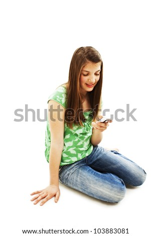 Picture of happy teenage girl with cell phone. Isolated on white background. - stock photo