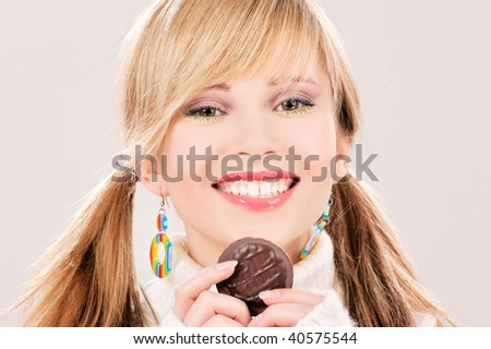 picture of happy teenage girl with cookie - stock photo