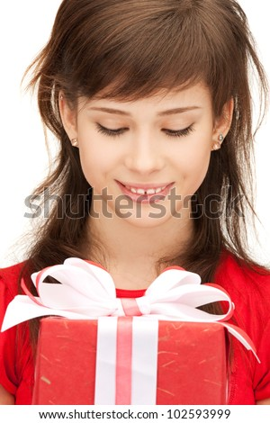 picture of happy teenage girl with gift box