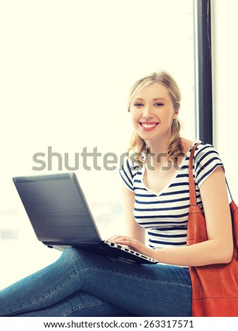 picture of happy teenage girl with laptop computer - stock photo