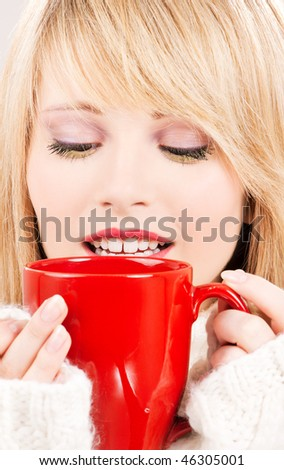 picture of happy teenage girl with red mug