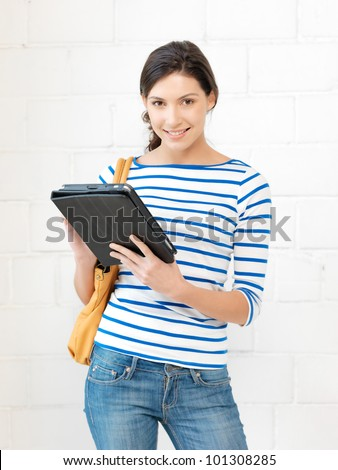 picture of happy teenage girl with tablet pc computer - stock photo