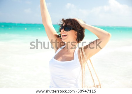 picture of happy woman at the beach - stock photo