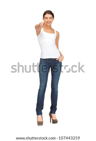 picture of happy woman in blank white t-shirt poining her finger