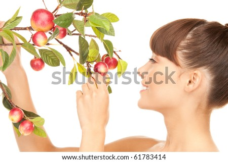 picture of happy woman with apple twig