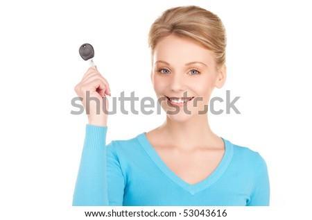 picture of happy woman with car key over white - stock photo