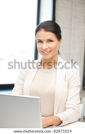 picture of happy woman with laptop computer - stock photo