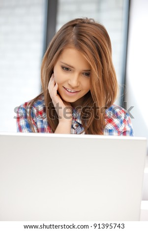 picture of happy woman with laptop computer