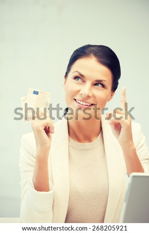 picture of happy woman with laptop computer and euro cash money