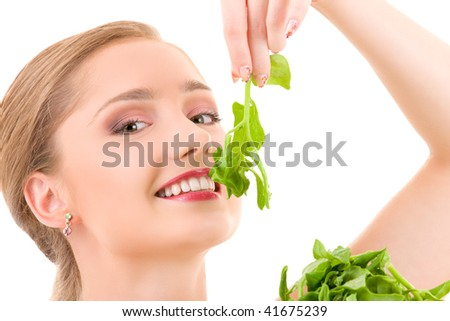 picture of happy woman with spinach over white - stock photo