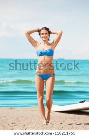 picture of happy woman with wind surf on the beach. - stock photo