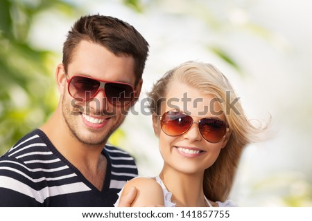 picture of happy young couple in the woods