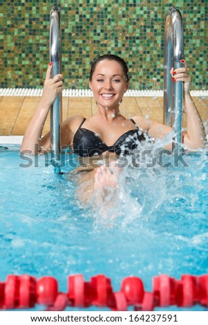picture of happy young woman having fun in pool - stock photo