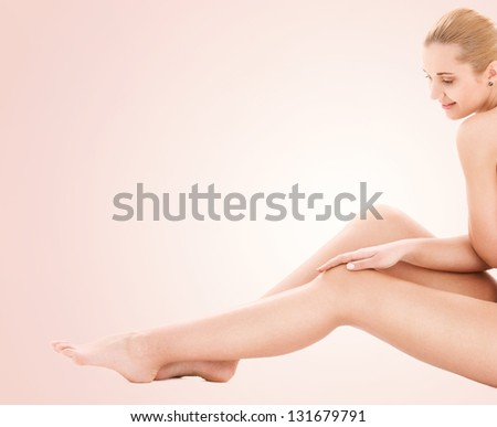 picture of healthy naked woman over beige