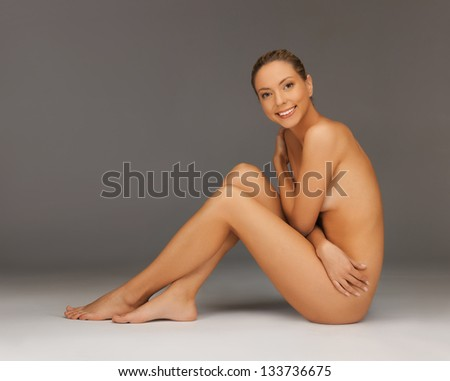 picture of healthy naked woman sitting on the floor - stock photo