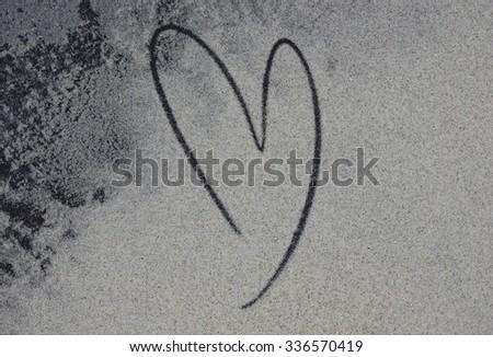 Picture of heart handwritten on golden sand. - stock photo