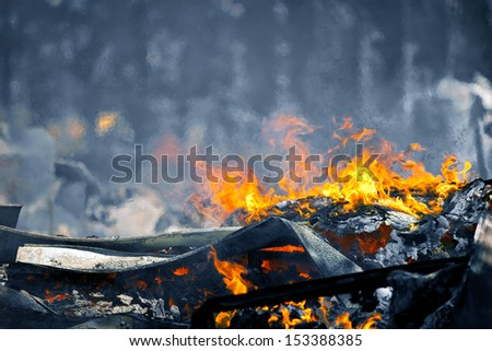 Picture of Heat caused by a Very hot Fire creating air movement effect. Cold image color with hot fire for more color contrast. - stock photo