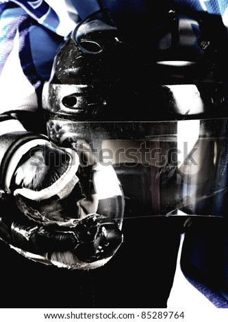 Picture of hockey helmet in hockey player hands - stock photo