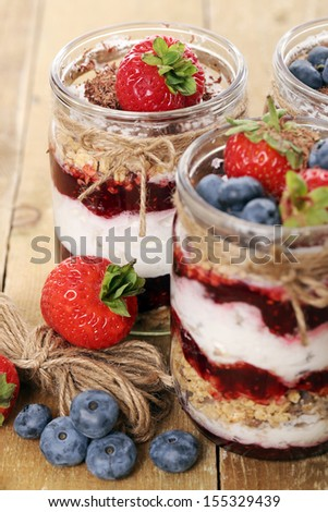Picture of jars with different berries - stock photo