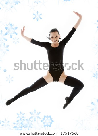 picture of jumping girl in black leotard with snowflakes