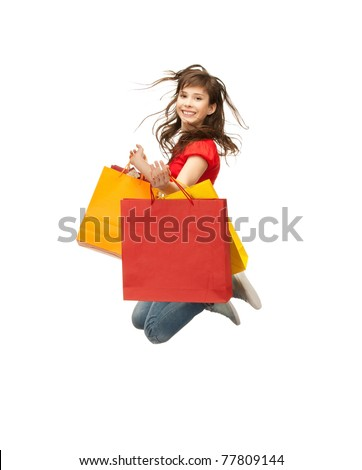 picture of jumping teenage girl with shopping bags - stock photo