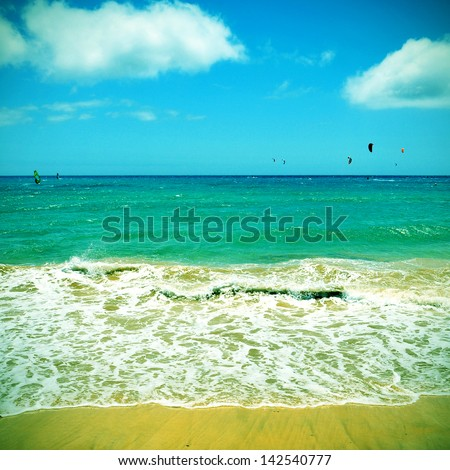 picture of kitesurfers and windsurfers in Sotavento Beach in Fuerteventura, Canary Islands, Spain, with a retro effect