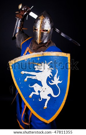 Picture of knight in battle - stock photo