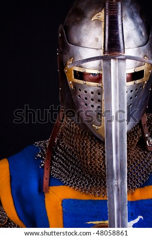picture of knight wearing helmet and holding sword - stock photo