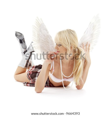 picture of laying lingerie angel blonde in checkered skirt - stock photo