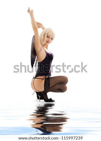 picture of lingerie angel girl in stockings on white sand - stock photo