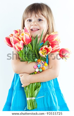Picture of litlle girl with tulips in hands over white - stock photo