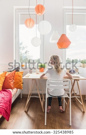 Picture of little girl in her bedroom - stock photo