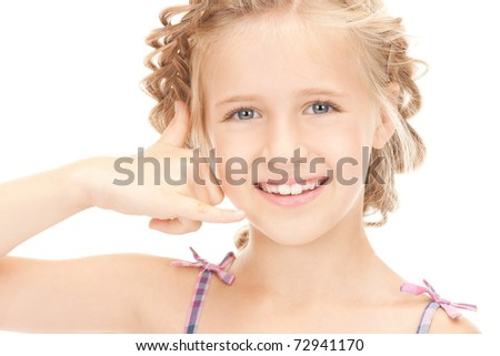 picture of little girl making a call me gesture - stock photo