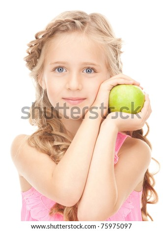 picture of little girl with green apple - stock photo