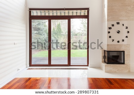 Picture of living room with big window - stock photo