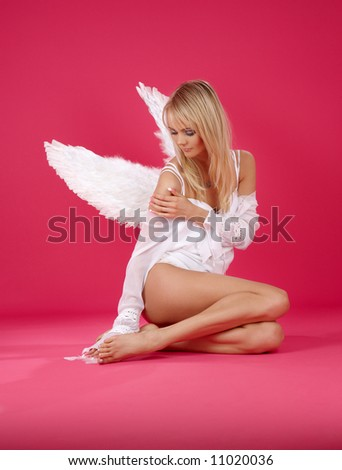 picture of lonely angel girl over pink - stock photo