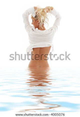 picture of lovely blond in water pulling hair up - stock photo