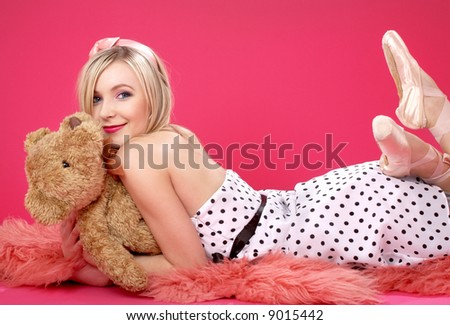 picture of lovely blond with teddy bear over pink - stock photo
