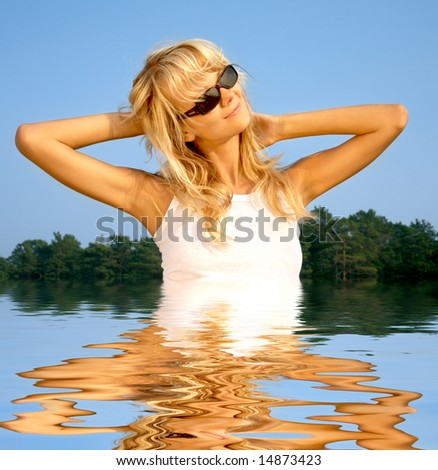 picture of lovely blonde relaxing in water - stock photo