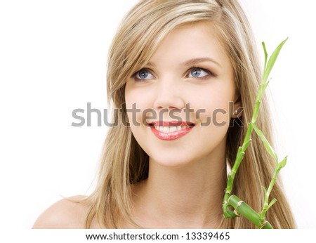 picture of lovely blue-eyed blonde with bamboo - stock photo
