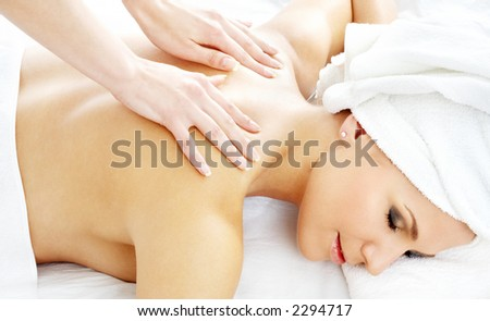 picture of lovely lady relaxing in massage salon - stock photo