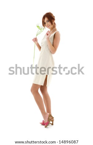 picture of lovely redhead with flower over white - stock photo