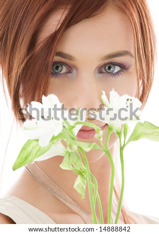 picture of lovely redhead with flowers over white - stock photo
