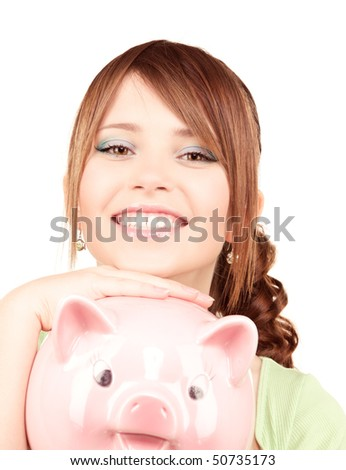 picture of lovely teenage girl with piggy bank - stock photo