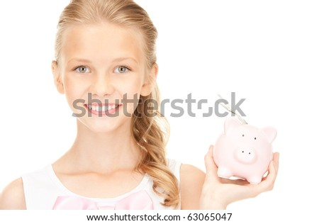 picture of lovely teenage girl with piggy bank and money - stock photo