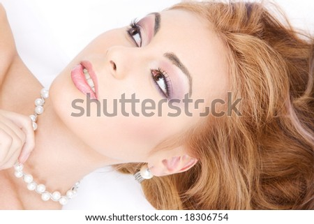 picture of lovely woman in pearls over white - stock photo
