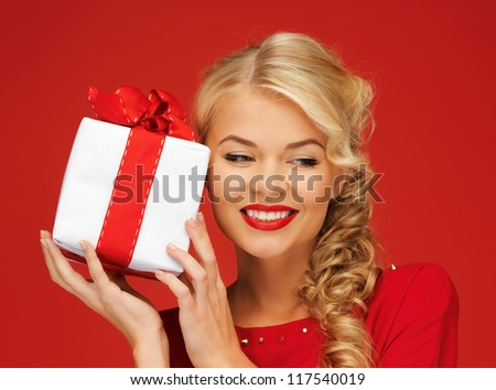 picture of lovely woman in red dress with present - stock photo