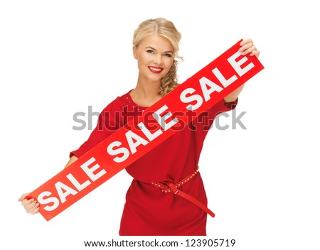 picture of lovely woman in red dress with sale sign - stock photo