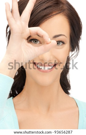 picture of lovely woman looking through hole from fingers - stock photo
