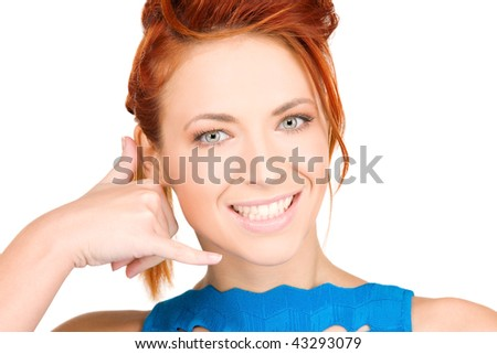 picture of lovely woman making a call me gesture - stock photo